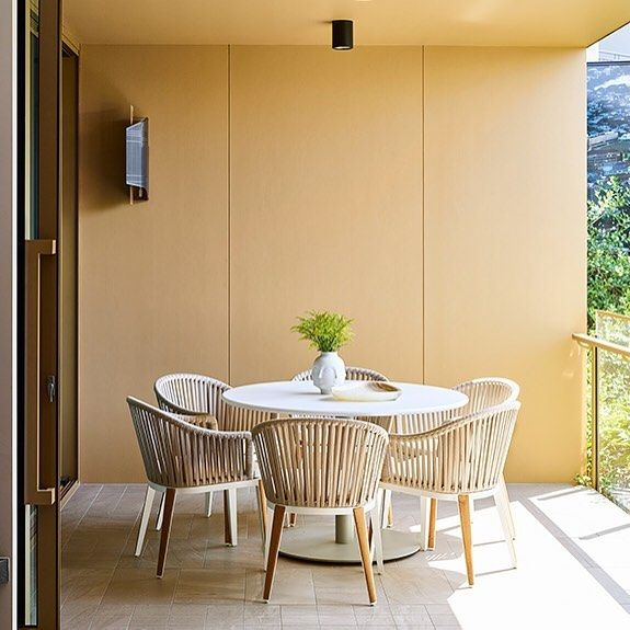 Summer dining meets apartment living with the Cayman Outdoor Dining Chair and Caledonia Outdoor Dining Table. As styled by Coco Republic Interior Design for the Lume display suite by @devcorp_ in Brisbane. #CocoRepublic #interiordesign #apartment #style #outdoors #summer