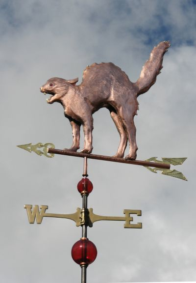 Scary Halloween Cat Weathervane by West Coast Weather Vanes.  This handcrafted custom made scary cat weathervane is typically made in copper with translucent glass eyes. It can be made with an optional collar and gold leafed teeth, whiskers and collar.