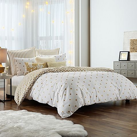 Rendered in lively shades of metallic and white, Anthology's Gold Glam Mini Comforter Set adds the perfect dose of glitz to your sleeping quarters. Its fun polka dot print reverses to a chic chevron design, giving your bed a fun look for endless dreaming.