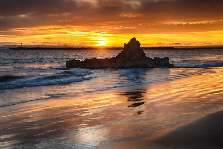 Photograph Submerged Rock at Sunset by Nazeem S on 500px