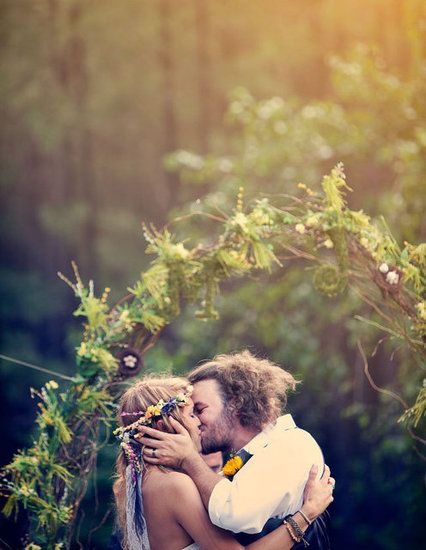 The Boho Dance: Beautifully Bohemian Wedding Decor: As if this couple wasn't bohemian enough — especially that bride's gorgeous homemade headdress! — their gorgeous green arch that looks like it's adorned with enormous fiddleheads ferns makes a beautiful statement.   Three Nails Photography via Green Wedding Shoes