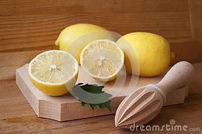 Picture with lemons on wooden background