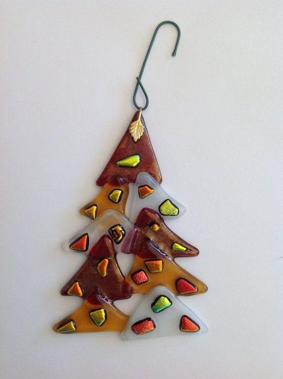 Fused glass Christmas tree.  I like the triangles layered.  Would be cool in various greens with bead-balls.