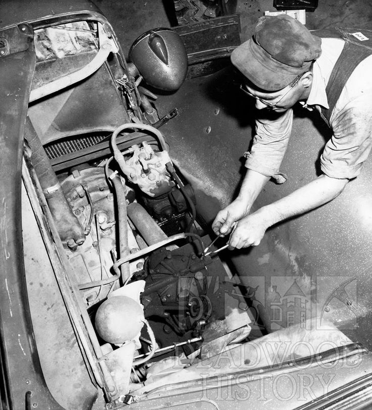In this 1960 photograph, John Jeffery works in Homestake's automobile repair shop. The shop was responsible for keeping Homestake's trucks and company cars in good working order. Homestake Mining Company Collection. #DeadwoodHistory
