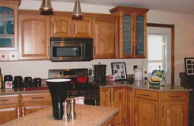 Shenandoah cabinetry winchester cathedral maple spice for Cathedral kitchen cabinets