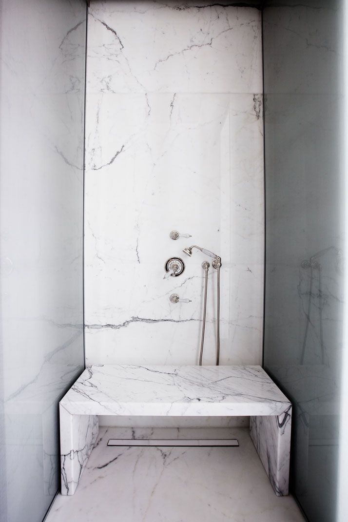 A Modern Apartment Near The Eiffel Tower, marble shower with marble bench | Yatzer