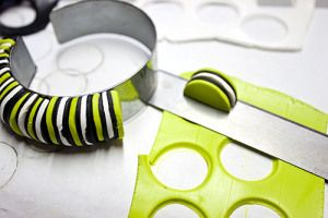 Stripey Bracelet tute - punch out circles & cut in half.  Apply to base.  #Polymer #Clay #Tutorials