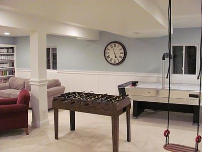 A game room on a smaller scale. Nice muted colors and plenty of seating.