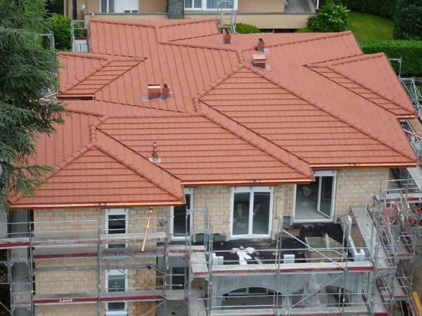 Hans Klopfenstein AG - Ihr Dachdecker im Zürcher Oberland -  Bedachungen – Gerüstbau – Dachreparaturen – Fassadenbau