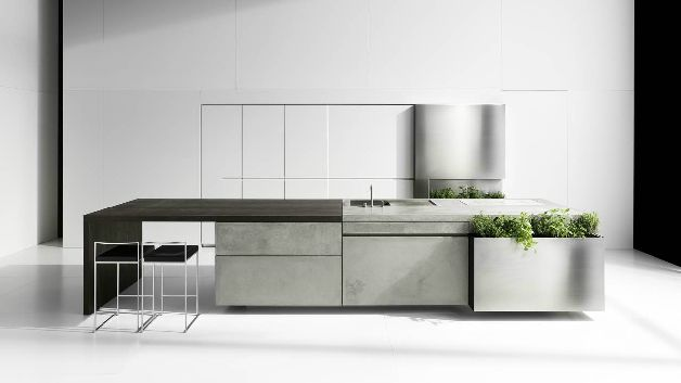 The Concrete Kitchen by Martin Steininger has been recently awarded the prestigious RedDot design award. The designer used  ultra-thin 8 mm concrete as a main visual element in this project. Heat resistant and safe for food, the material is a perfect match for the function of the kitchen. However, the manufacturing process has to be very precise and requires a certain know-how. Hand-polished surfaces, minimal details and appliances add to the slick and streamlined look.