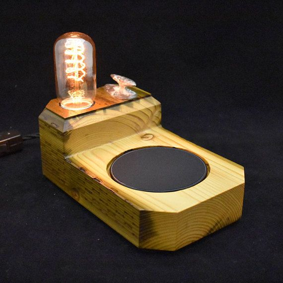 This unique multi-functional cell phone charger / 3-way touch lamp was created from a solid piece of reclaimed wood and a vintage boat dock cleat from the Marina Del Rey, CA harbor. Simply touch the cleat to enjoy a warm glow of light at the brightness you desire! Place your device