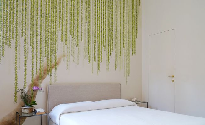 Bedroom wall in Misha's modern chinoiserie, Cranes at the Willow wallpaper design on White dyed silk.