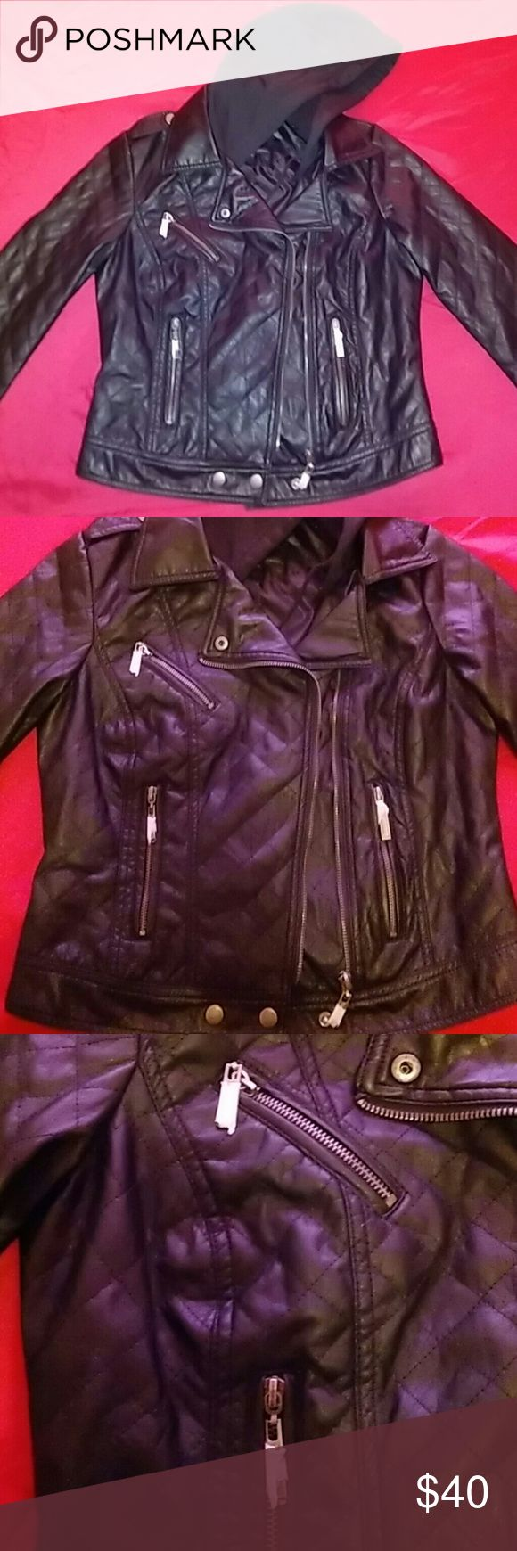 """Black Faux Leather Biker Jacket Never worn (except for this picture) - this jacket is BRAND NEW and even still has the zipper coverings on it! Got a fun motorcycle event coming up? Dating a biker? Just like the biker look? No matter what your reason, this jacket yells, """"Rebel!"""". Not to mention it's very comfortable and soft; it looks like real leather. It's fairly light weight too, so you could pull it off in milder temperatures! Also has a built in, removable hood for when it gets colder…"""
