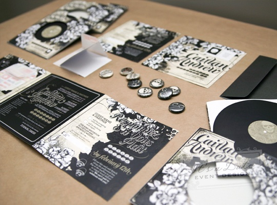 Black, white and pottery colored invitations centered around the groom's love of heavy metal music. Source: http://www.itsadatedesign.com