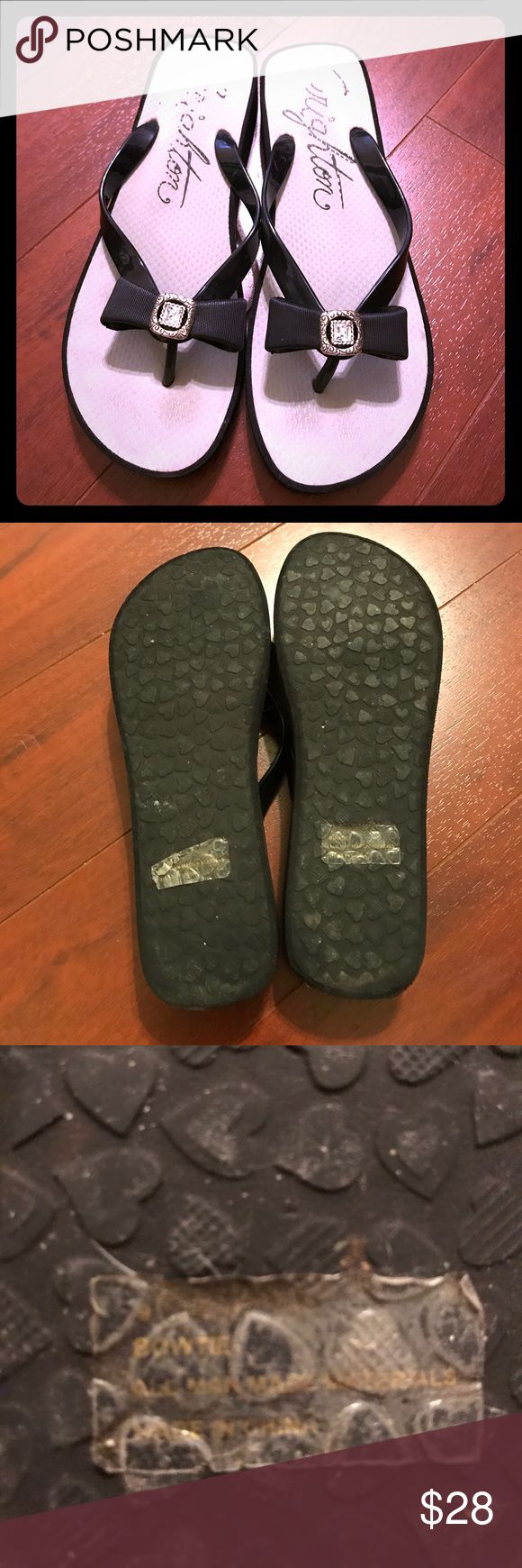 """Brighton """"Bowtie """" Wedge Flip Flops 9 Gently used black flip flops with jeweled bow detailing. Size 9. platform wedge sole. All man made material. From the Roxbury collection. $48 at Brighton Brighton Shoes Sandals"""