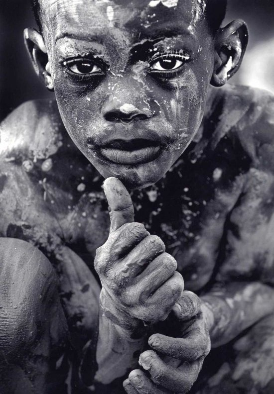 photo of 7 year old Sonson Pierre after a Hurricane in Haiti. Photo by Patrick Farrell
