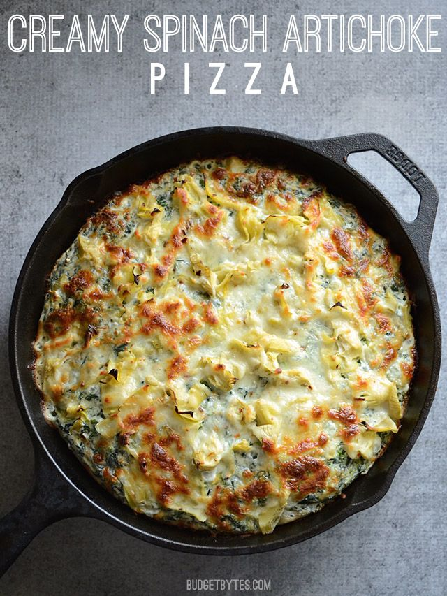 Creamy Spinach Artichoke Pizza- skip the bread layer and cook over chicken thighs instead - BudgetBytes.com