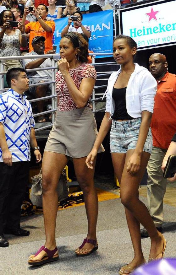 Michelle Obama and daughter Sasha arrive to watch the Oregon State University vs University of Akron college basketball game looking like hell, as usual. Comment is dedicated to Barry B. Enjoy the bums!