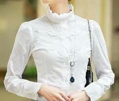 Beautiful high necked blouse with georgeous crochet detail