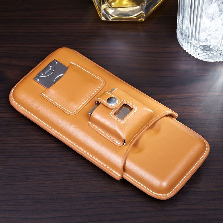 Carry your cigars in style with our 3 cigar holder. This Italian leather cigar holder is a great gift for cigar aficionados on the move and includes a stainless steel cigar cutter and lighter, so he...