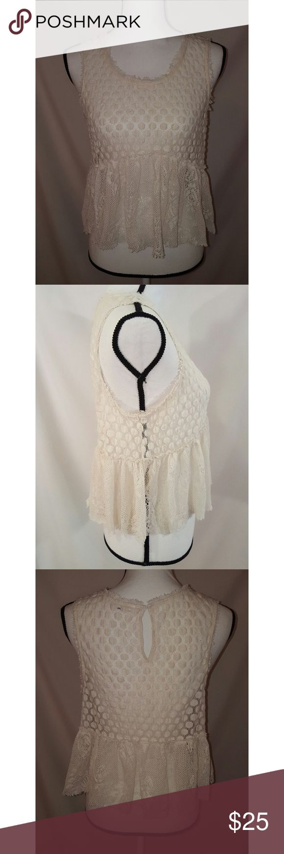"""Free People Ivory Lace Baby Doll Boho Top Medium This is an off white lace polka dot flowy short boho top. It is in very good condition.   Flat across pitto pit 18.5"""" waist 18.75"""" Length 20#  Storage location #275 Item # 2667 Free People Tops"""