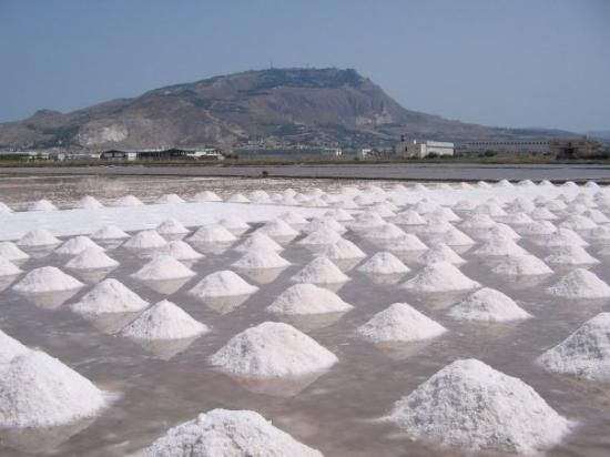Trapani, Sicilia I remember my mom telling me about seeing the piles of salt.....I must go there one day!