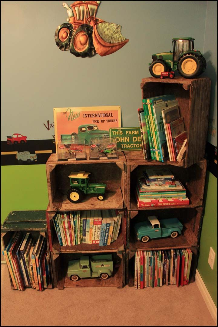 Crate Shelves - boys room.  Finally found the perfect solution to store all of my boys books.  Old wooden crates from a nearby vegetable farm.  Love the colours and vintage look they have.  The boys loved it too.