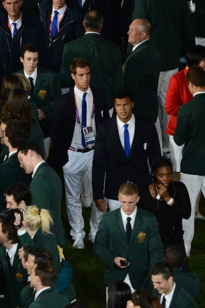 France's tennis player Jo-Wilfried Tsonga (C) walks with his country's delegation during the opening ceremony of the London 2012 Olympic Games on July 27, 2012 at the Olympic stadium in London.