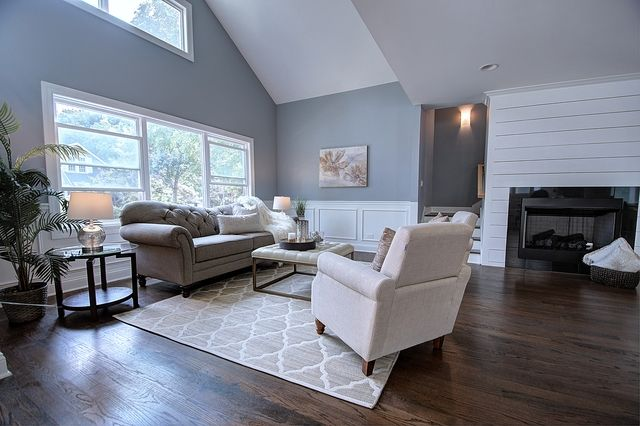 Modern And Contemporary Living Room With Dark Hardwood Floors Vaulted Ceilings Recessed Lighting Living Room Leather White Wainscoting Beautiful Living Rooms
