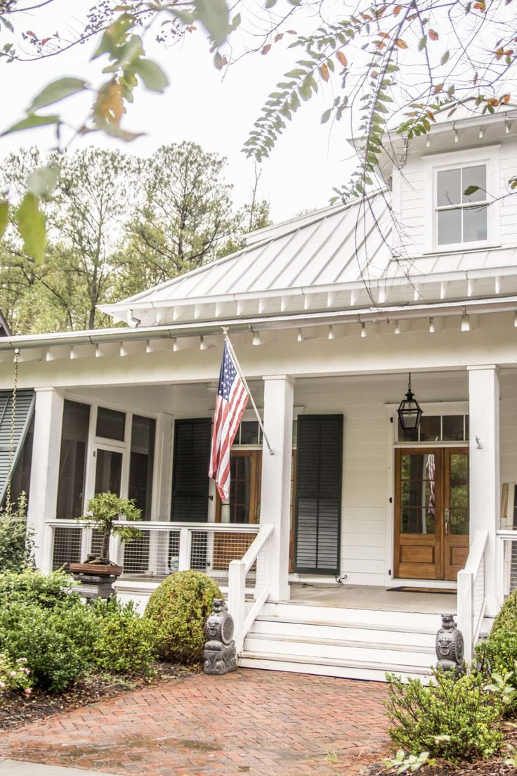 Front porch with shutters and tin roof in Serenbe, Georgia on Thou Swell @thouswellblog