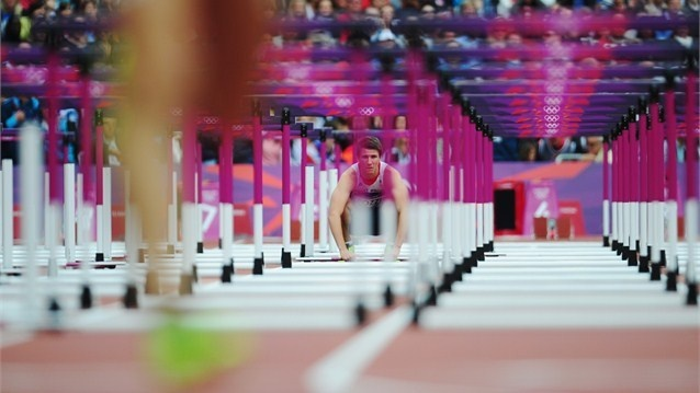 Andrew Pozzi of Great Britain looks on after pulling out of the men's 110m Hurdles Round 1 Heats on Day 11 of the London 2012 Olympic Games at the Olympic Stadium.