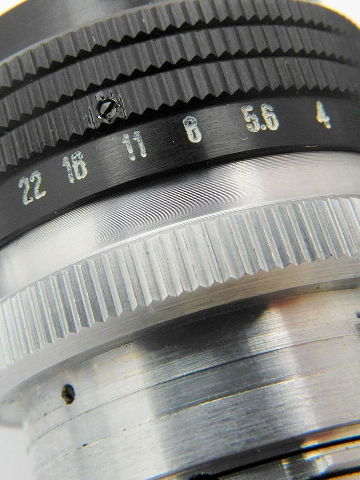 """The Helios-103 53 mm f/ 1.8 (Russian: """"Гелиос"""") is a fast standard lens with a fixed focal length for 35mm rangefinder cameras of a Contax system."""