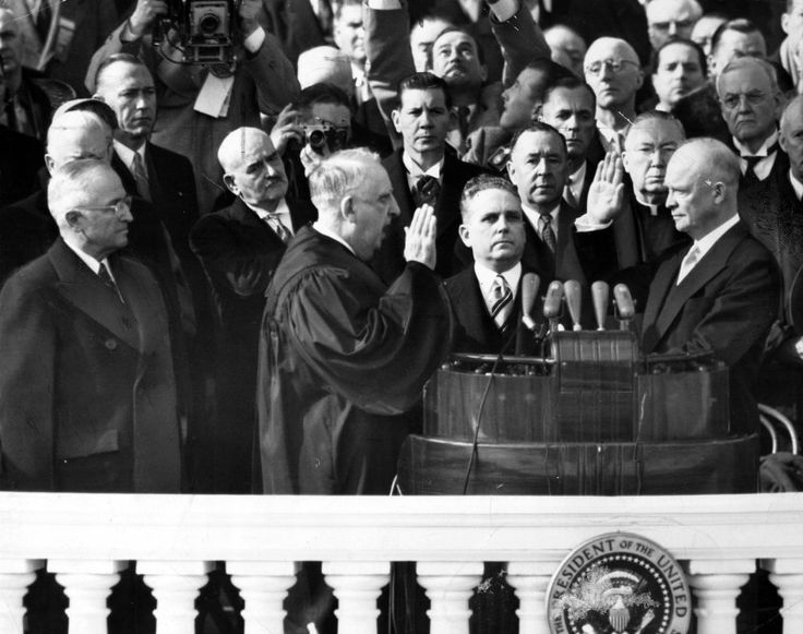 "DWIGHT D. EISENHOWER takes the Presidential  Oath of Office using two Bibles: (1) The Bible used by George Washington in 1789, opened to II Chronicles 7:14; AND (2) his own personal ""West Point Bible,"" opened to Psalm 33:12.  The oath was administered by the HONORABLE FREDERICK VINSON, Chief Justice of the United States.  -- January 20, 1953"