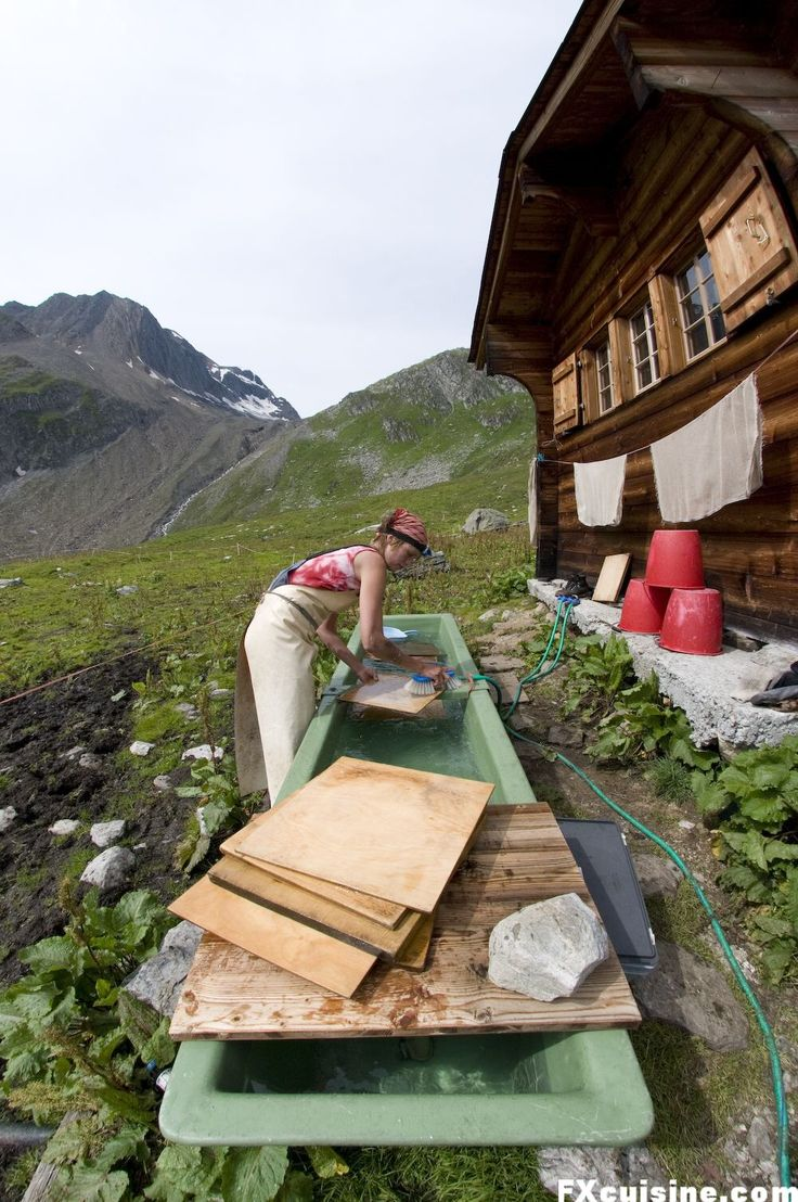 Swiss Alps Cheesemaking -- My visit of a 8000'/2400m high cheesemaking chalet in the Swiss Alps where cheese is still made like 300 years ago - and not one tourist in sight!   I just love this photo of the cheesemaker scrubbing her equipment in an outdoor trough.