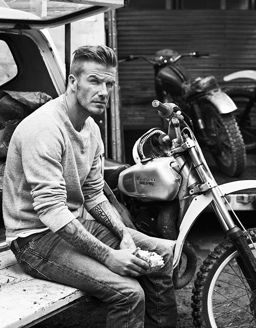 What a great shot of Beckham  the casual posture, the squint, the tattoo sleeves, the motorcycle in the background I know the bad boy image is clich�� and often ridiculous, but he actually manages to pull it off here. Men | tattoos picture beckham tattoo
