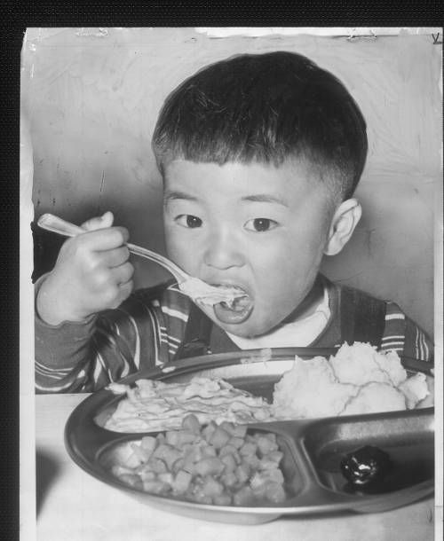 """Page 1 :: """"Little Boy, Big Appetite"""" -- caption on photograph :: Japanese American Relocation Digital Archive, 1941-1946. http://digitallibrary.usc.edu/cdm/ref/collection/p15799coll75/id/1788"""