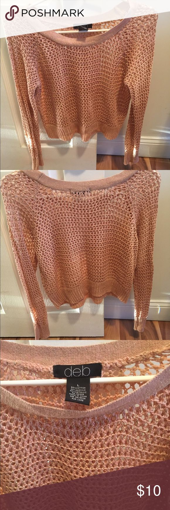 Deb shop crop top Hi, up for sale is this net crop sweater top with gold speckles, this sort of Rose Gold, Peachy Pink tone color is super popular right now. It's a size L but would fit a person who wears a Medium or Large. I maybe wore this about 3-4 times but it's in great condition. Deb Sweaters Crew & Scoop Necks