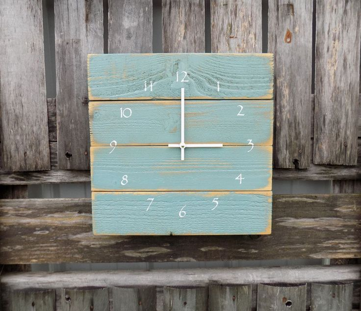 This rustic beach style clock is painted with a patina blue/sea foam color. It is distressed to give it the perfect amount of rustic charm. White numbers and straight modern white clock hands finish t