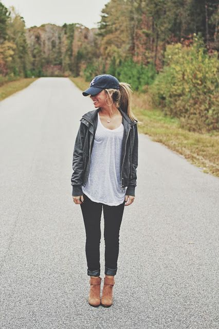 casual baseball cap with loose shirt, skinny jeans and boots.