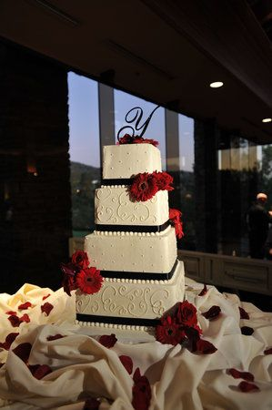 beautiful red black and white wedding cake  Shanna we could do blush flowers instead of red...?