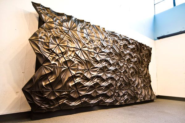 James Diewald: Aeolian Lanes is a superformed aluminum rain-screen prototype. Two panel types produce a range of geometry-induced surface effects, which operate at multiple scales through pattern.