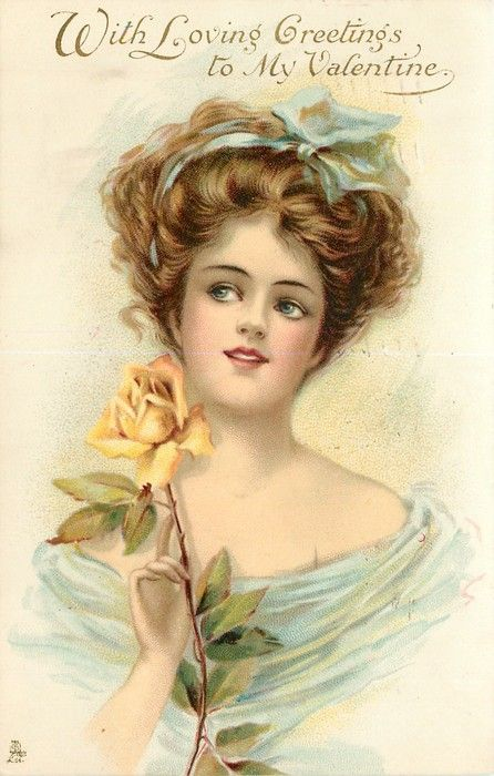 woman holds single yellow rose by her right cheek