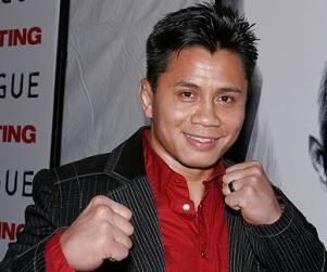 Check out Cung Le, Sanshou fighter, ex Strikeforce Middleweight Champ, and an all American Wrestler. http://www.mmaacupuncture.com/acupuncture_mma/2012/07/kung-fu-in-mma-cung-le-and-sanshou/