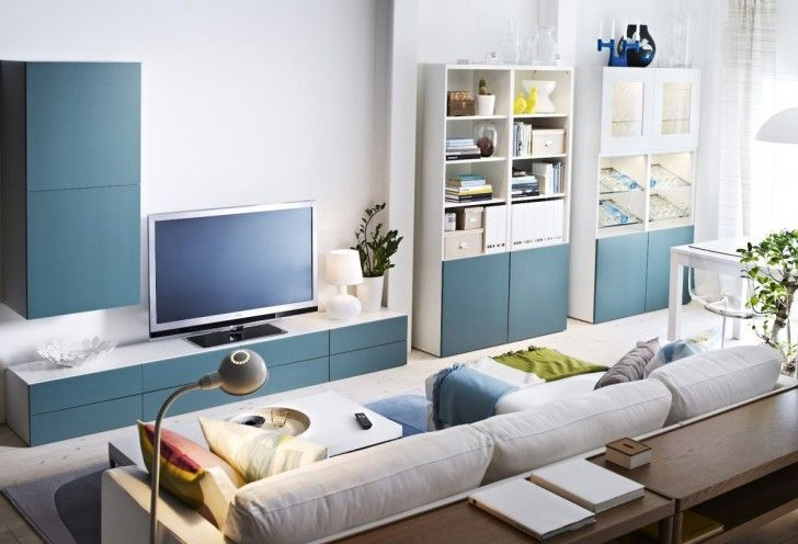 Comfortable living room in blue style ikea furniture with white ceramic table lamp, and sky blue solid wood credenza with white tops. Ivory fabric sectional sofa with wooden coffee table with gray floor lamp cap, and blue and white wooden storage cabinet design inspirations