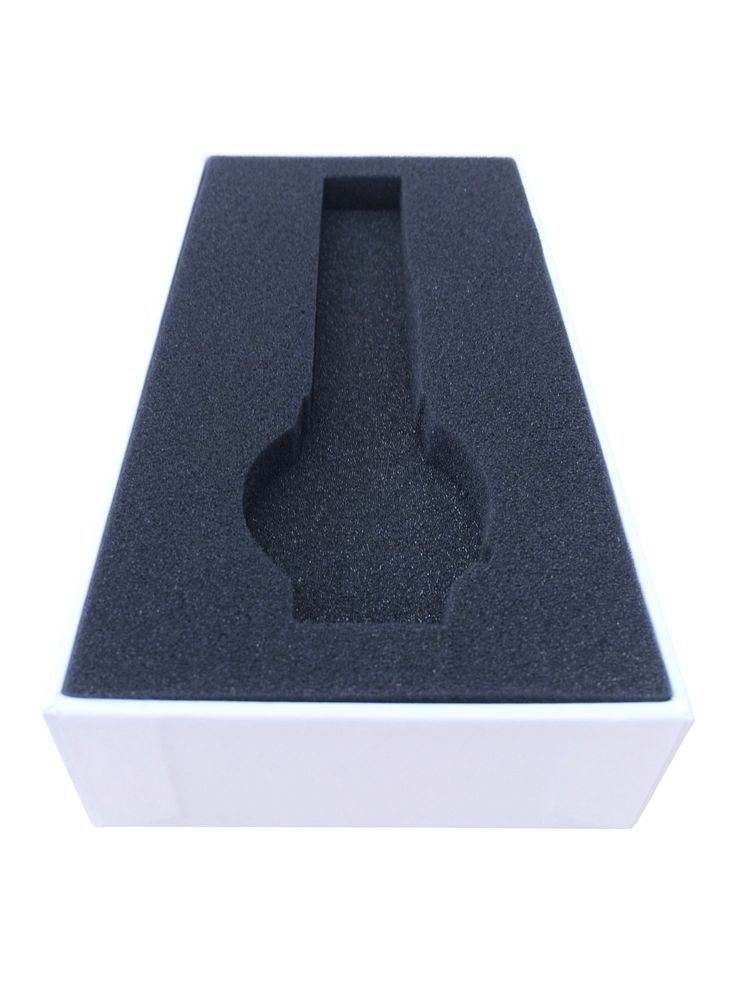 Die cut insert. Product packaging box for watch with custom black foam insert