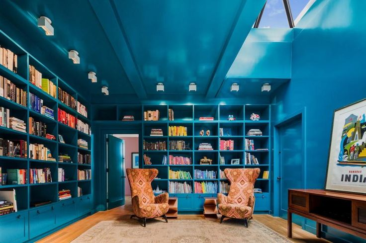 Natural skylight juxtaposing with an eclectic mix of colors and textures make this cozy library a unique stunner.