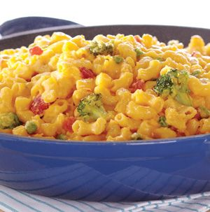 Turn ordinary macaroni and cheese into a meal. Classic Mac 'n' Cheese is hearty and delicious thanks to peas, broccoli and tomatoes. Three kinds of cheese don't hurt either!