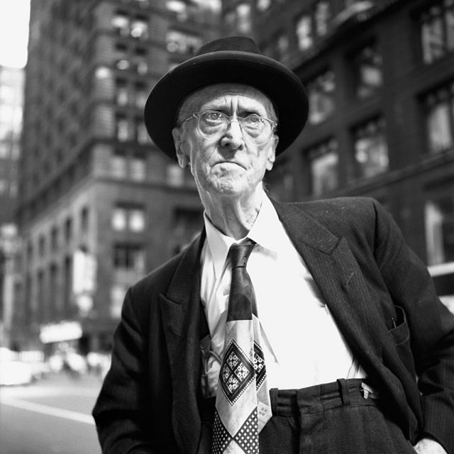 Street Life in American Cities During the Last Century - Man with Character HH: You got to love where the waist of his trousers cinches up. High on the torso. Other old men have it way down low below the belly. It's usually one extreme or the other.