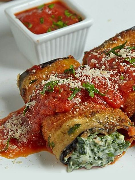 This eggplant is breaded, fried, and wrapped around a yummy creamy filling! No one can resist these Eggplant Roll Ups with Cream Cheese and Spinach! http://www.joyofkosher.com/recipes/eggplant-roll-ups-with-cream-cheese-and-spinach/