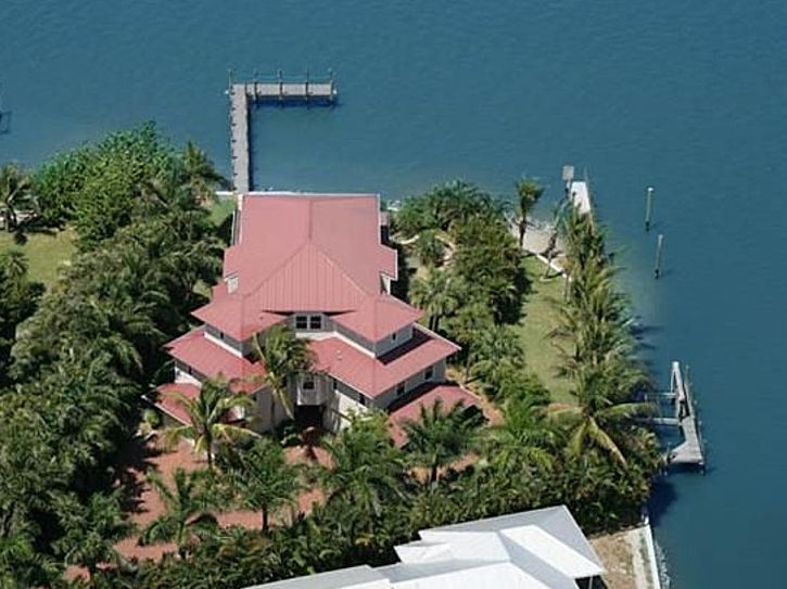 "5 Bedroom [2 Large Master Suites] 5 Bath, 4,200 Sq Ft Waterfront Estate Tropical pool and hot tub 240 Foot dock 16,000 lb. Boat lift 240 Feet of water frontage Huge .62 acre lot Large panoramic decks on all floors Elevator King size bed in all five bedrooms 55"" TV with digital HD cable in all bedrooms High-speed WiFi Professional kitchen and appliances Full size laundry room Tropical landscaping Four-stall garage Multimillion dollar custom home constructed in 2006  Location, Location…"
